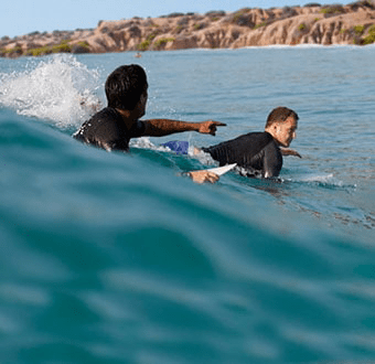 Surfing Assistance while riding waves by Cabo Surfer